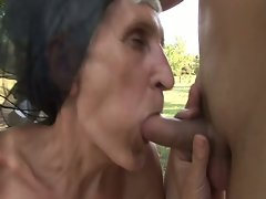 Slutty granny fucks under the tree