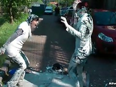 Two ladies fight with wet paint