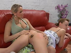 Lesbian gal gets spread and ass-fucked on the sofa by a strap-on...