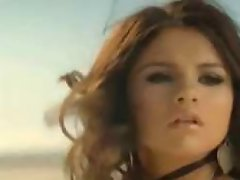 Young and sexy singer Selena Gomez on he music video of A Year...