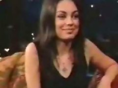 Mila Kunis having a great time on her interview on a late night tv...