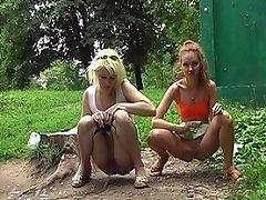 Fair gals in minis make a pee outdoors...