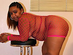 Alize is all wrapped up in her pink fishnet bodysuit today and...