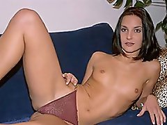 Beautiful brunette Charisma is passing the time masturbating, with...