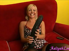 Aaliyah Love hot chick holding a gigantic black dildo