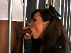 Lisa Ann blowjob as she crouches in her police uniform