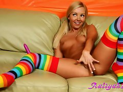 Aaliyah Love on colorful socks finger jabbing on couch