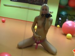 Sabrina Blond blonde chick wearing a pink strap on