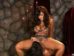 Lisa Ann sitting on the face of a hot babe