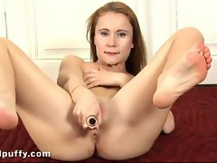 Redhead Amber rubs clit and toy fucks ass