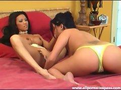 Sensual Asian lesbians enjoy giving each other pleasure
