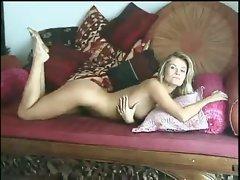 Sweet little tits blonde in seductive striptease
