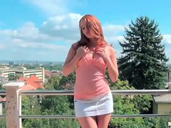 Perky redhead minx showing off her curves outdoor