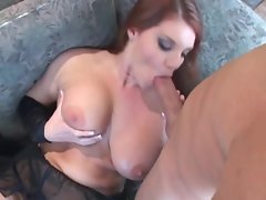 Sultry redhead with huge melons and kinky black stockings gets boned