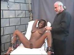 Bound ebony babe gets her pussy clipped open