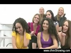 Horny girls enjoy the show in the fitting room of clothing store
