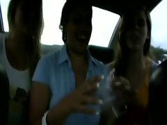 Slutty college amateurs suck cock in the back of a car