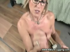 Cougar lady is jacking off a cock