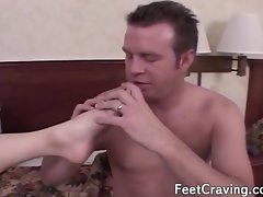 Cute girl getting her toes sucked