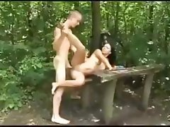 Brunette on the beach and in the woods gets bent over table to fuck