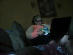 Big chubby brunette is watching porn on her computer and getting horny