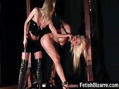 Tied up lesbian slave gets punished