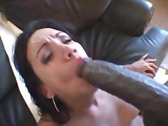 Busty brunette Giselle sucks on a big black cock and gets nailed for a mouthful