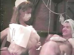 Vintage hardcore action in the dungeon with naughty nurses and a patient