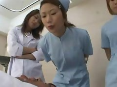Naughty young Oriental nurses take turns spit swapping with their male patient