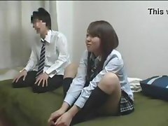 Asian schoolgirl is watching TV with friend and then blows and fucks him