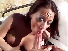 Nasty brunette whore undresses on the balcony then blows him and gets banged