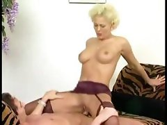 Mature blonde bitch teases his stiff cock and gets hammered hard