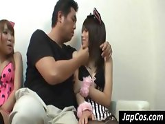 Two Asian girls in cat costume are teasing and kissing horny guy