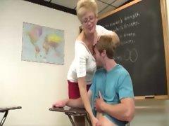 Granny teacher tugging cock for her lucky student