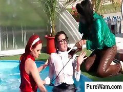 Three girls take a dip in the pool fully dressed and start horsing around