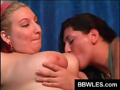 Overweight lovely lesbian lovers do each other on a black sofa