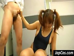 Chubby Japanese bimbo takes it from behind with her blue swimsuit still on