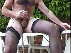 Wanking in the garden in stockings