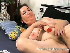 Granny toying her fresh shaved slit