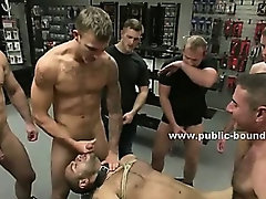Man tied in chain leash spanked with cocks over mouth and drilled by experienced bondage masters