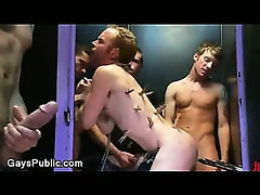 Bound gay anally machine fucked in porn booth
