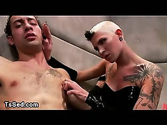 Tall tranny jerks off cock to bound guy in madhouse