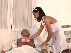 Sexy nurse Black Angelica cures her patient's hard cock