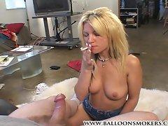 Drunk slut smokes a cigarette while sucking dick.