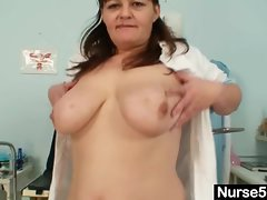 Big tits aged lady wears nurse uniform and gets naughty