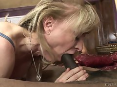 Nina Hartley chokes on a massive throbbing dick