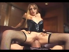 Cunnilingus and fucking in fishnet stockings and corset