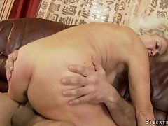Rampant granny rides her soggy minge on a stiff cock