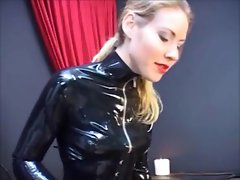 Mistress Capone demonstrating her dominance over two slaves