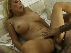 Busty mature bathroom action